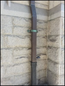Downspout Tansitioning to Cast Iron Drain Tile