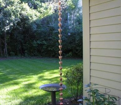 copper cup rain chain installed on home