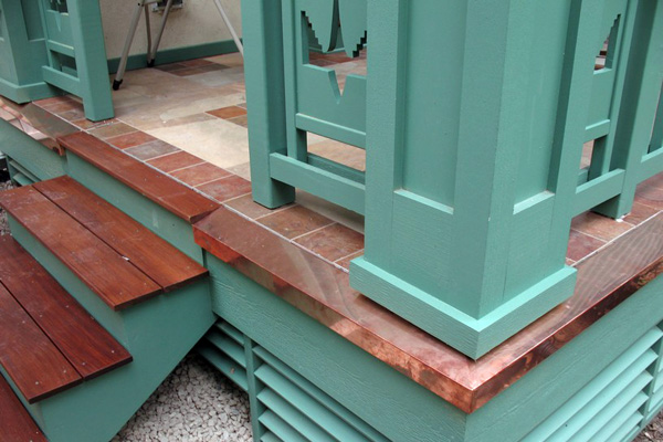 Copper trim around a custom sea green deck