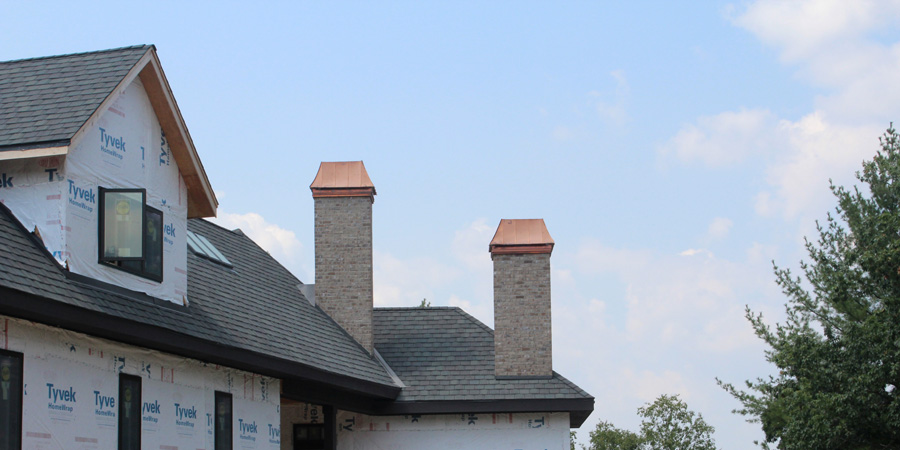 Copper-Shrouds-and-Grand-Manor-Shingles-installed-in-Oconomowoc-WI