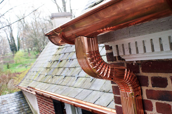 copper half round gutter with rectangular downspout