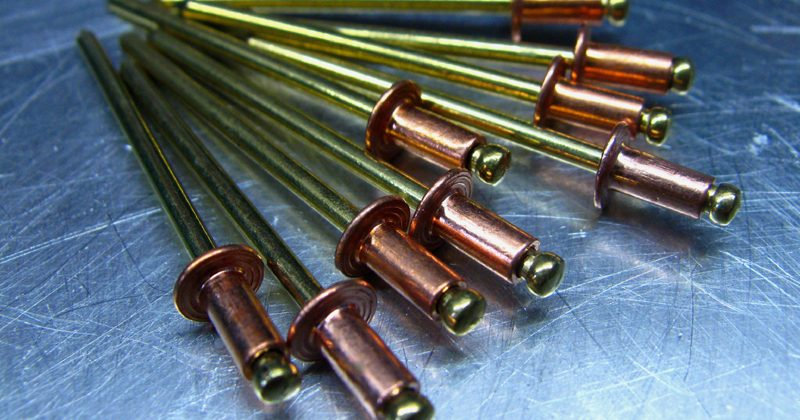 Copper rivets with brass mandrels